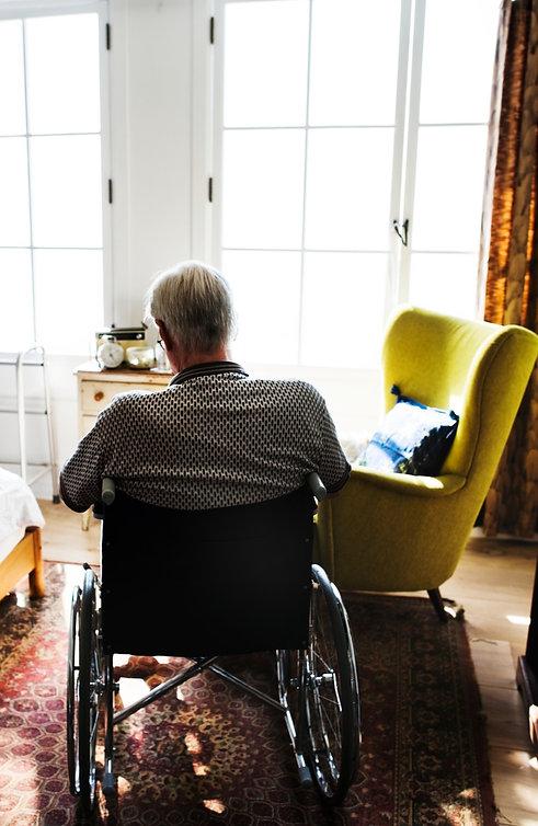 Senior man sitting on the wheelchair alone_edited.jpg