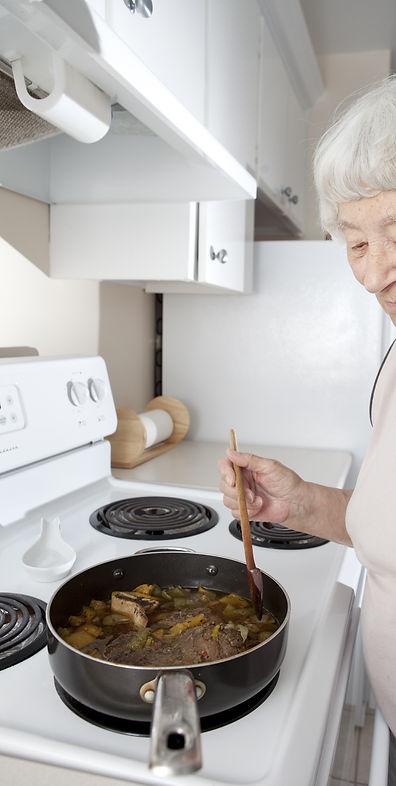 Senior woman cooking_edited.jpg