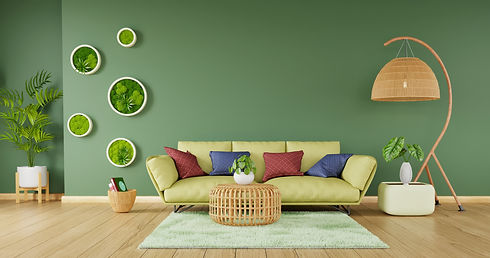 Five round moss frames hanging on a living room wall