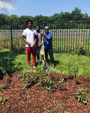 Students plant a rain garden in Berlin, MD
