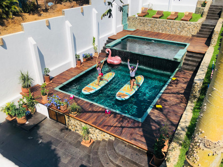 Stand Up Paddleboard Yoga in the cascade pool at Casa de Olas