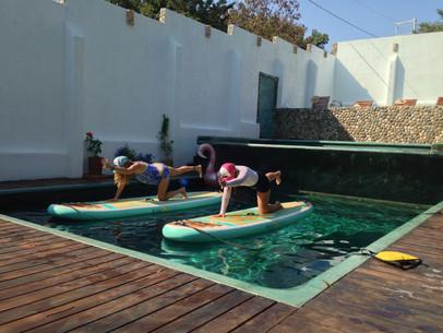 Balancing table top paddleboard yoga pool session