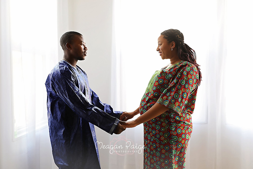 Pregnant Couple in Traditional Clothing