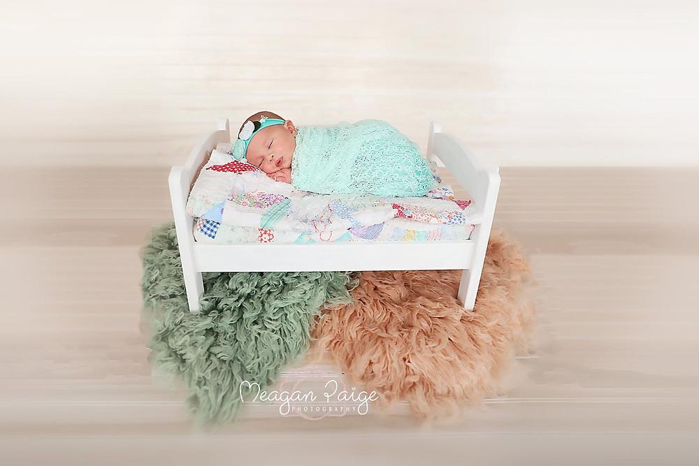 Baby Girl snuggled in bed