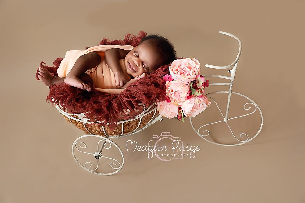 Newborn Girl in Floral Bike
