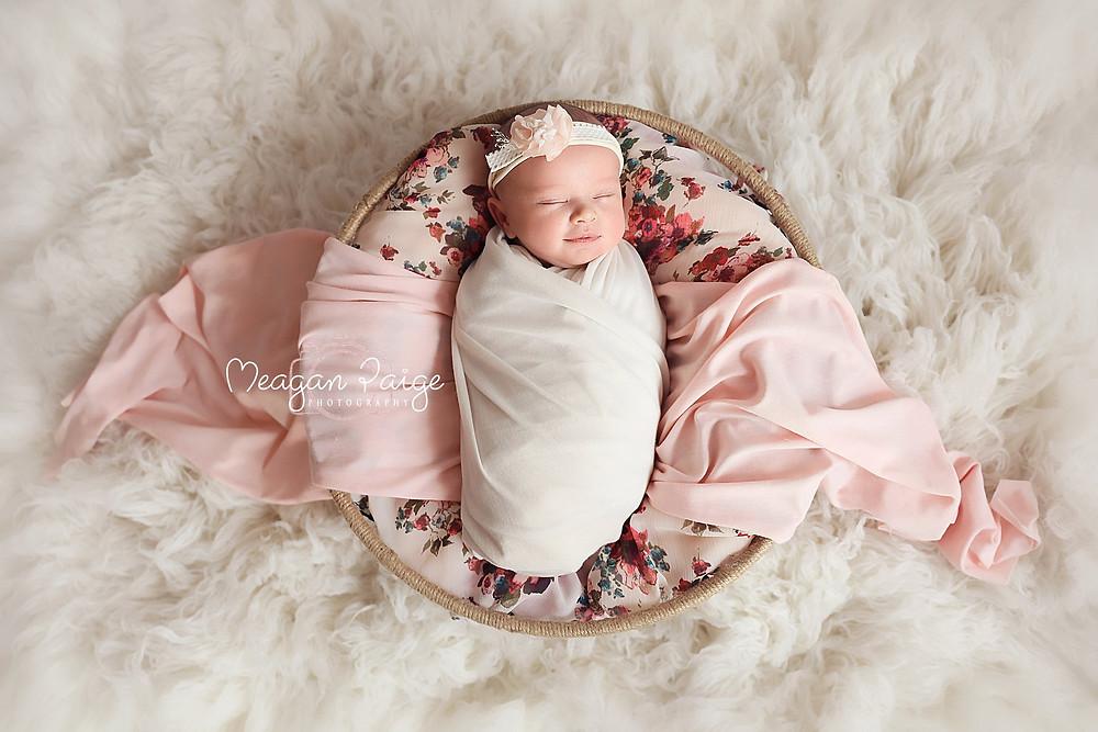 Baby Newborn Girl Smiling in her sleep