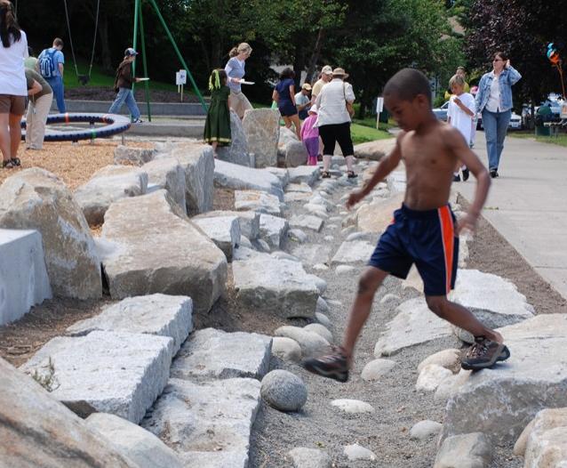 Rainwater playground drainage mosaic boulder