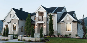 Black windows, gray house, gray exterior stone, black gutters