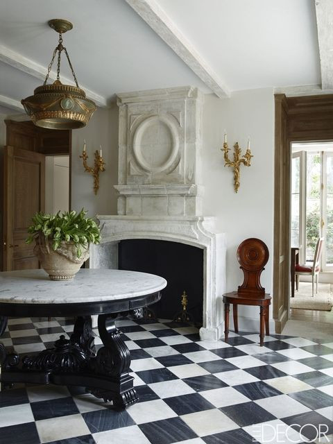 Limestone fireplace, Black and white marble flooring, Emma Jane Pilkington home, European home style
