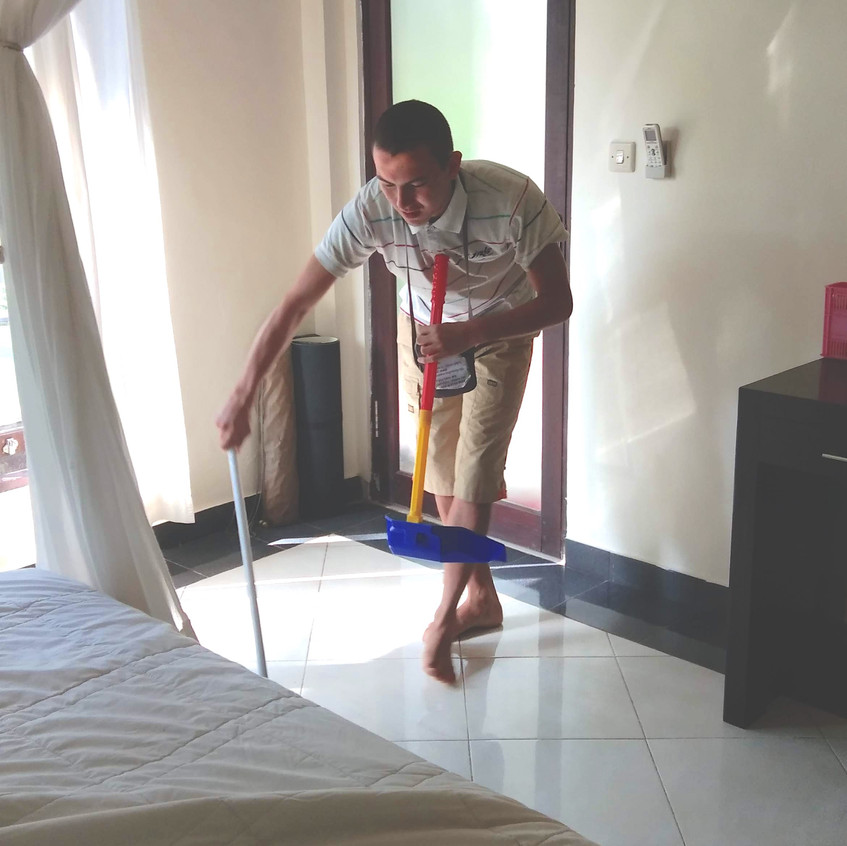 Seb cleaning up his room
