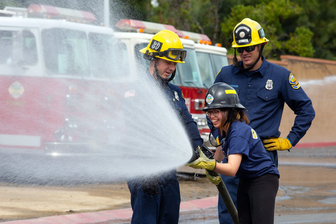 Teen girls rappel down buildings, learn firefighting during empowerment camp