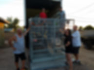 Curt Scarberry, Candis Scarberry, Tyler Odekirk and Randal Allyn unloading and HQ Bird Cage from the moving truck at AZ Exotic Bird Rescue in Scottsdale, AZ. Volunteers also pictured.