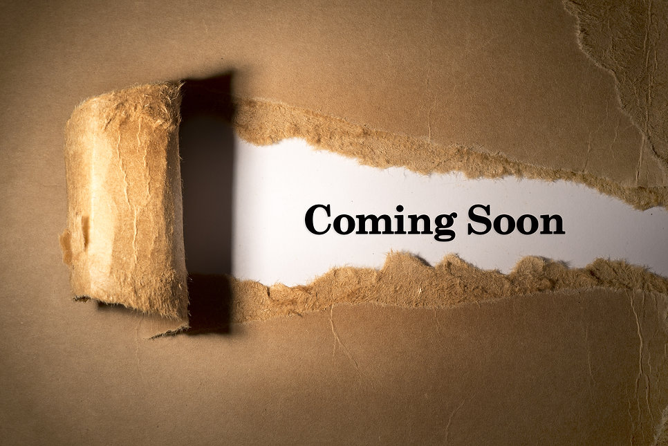 Torn paper box with word coming soon in