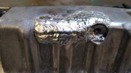 Riparazione coppa dell'olio d'auto crepata in alluminio