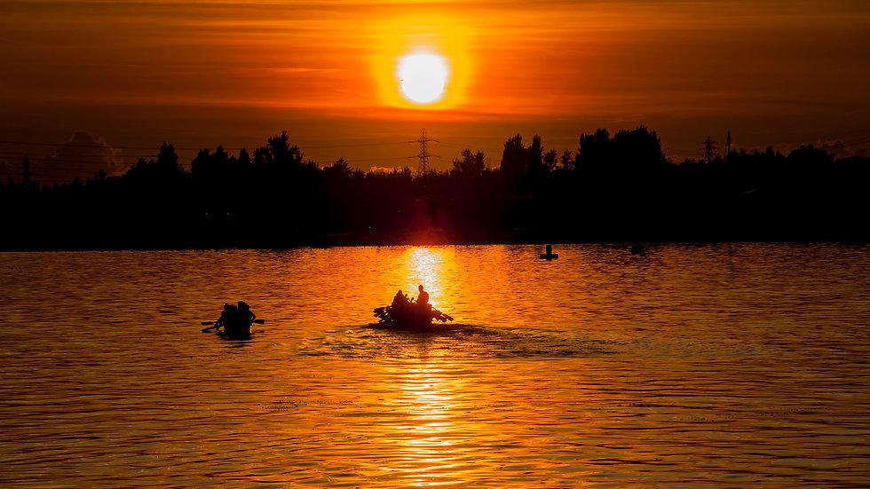 Dragon Boats at Sunse