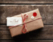 Picture of a gift wrapped in brown paper
