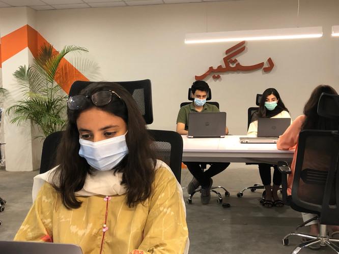 Dastgyr Team at work in Karachi office.JPG