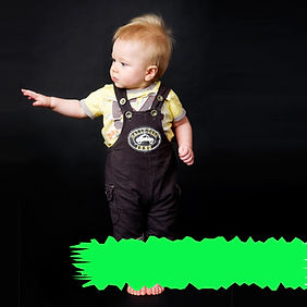 toddler-standing-while-his-other-arm-is-in-midair
