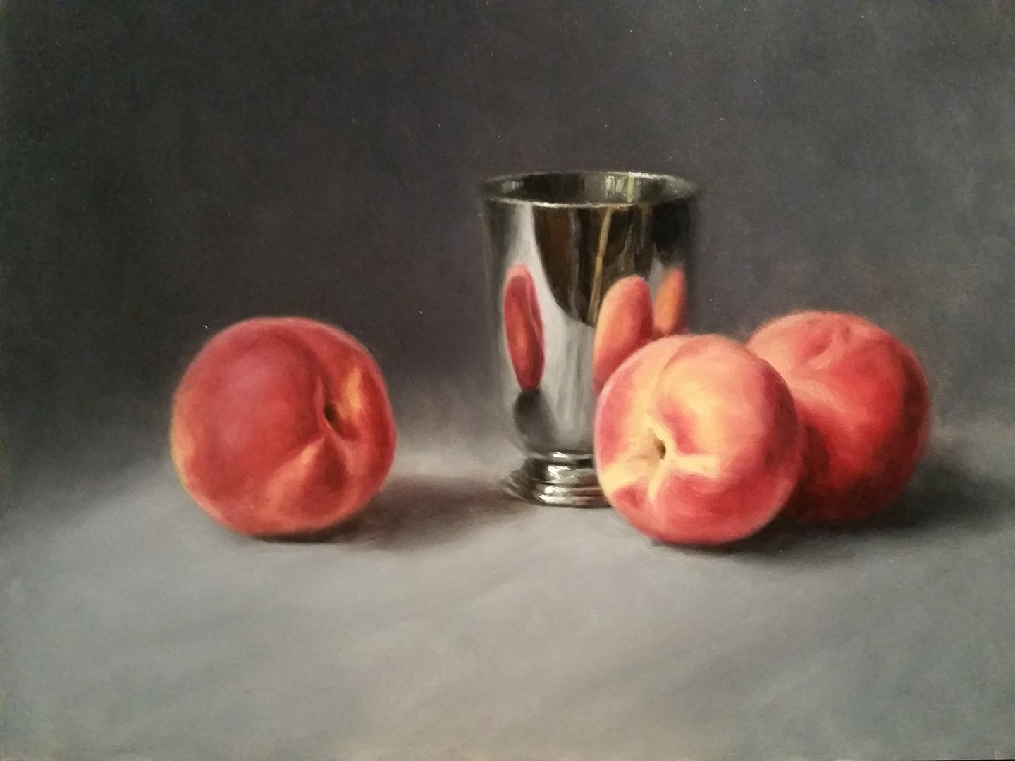 Peaches and silver cup