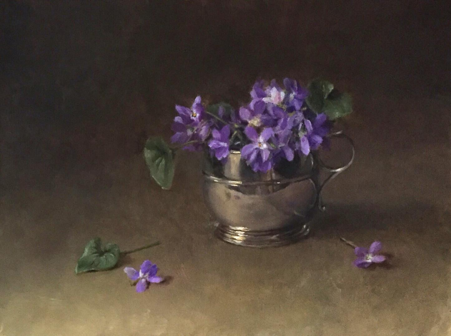 Violets in christening mug