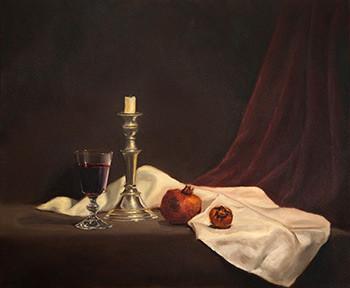 Candle, wine & pomegranates