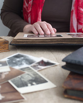 midsection-of-woman-holding-vintage-phot