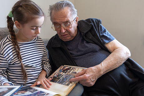 grandpa-is-looking-at-a-photo-album-with