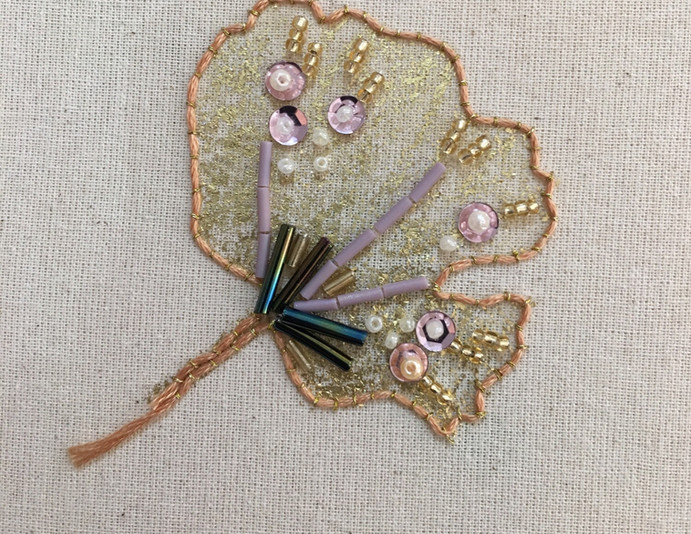 Embroidered and embellished floral detail.
