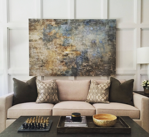 how to hang art above sofa