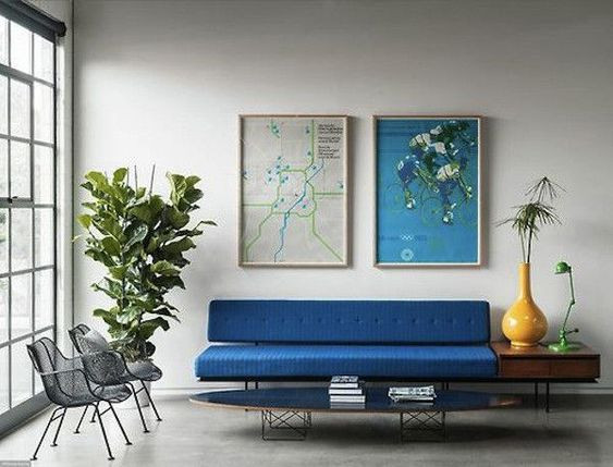 cobalt blue sofa and yellow accents
