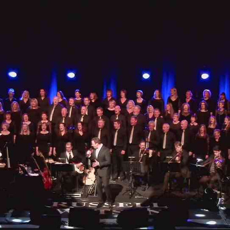 Conducting the Scottish Police and Community Choir providing backing vocals for Russell Watson on tour in Scotland.