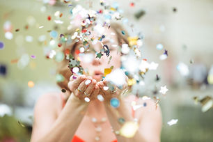 Girl Blowing Confetti.jpg