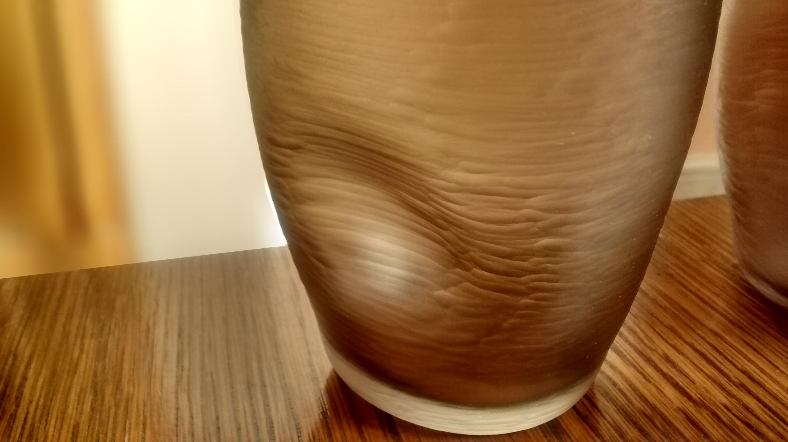 Ergonomic cut glass tumbler