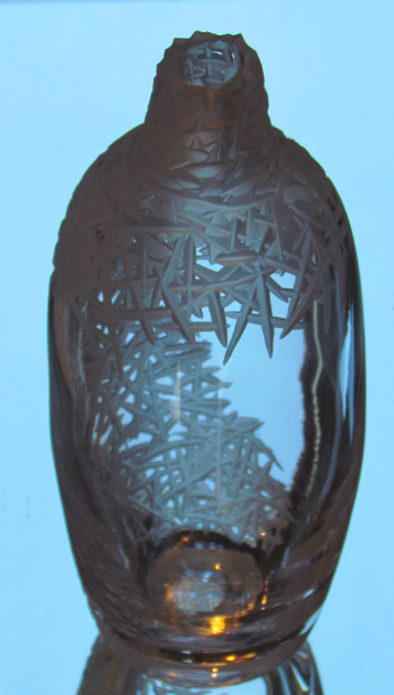 Clear bottle with criss cross cuts