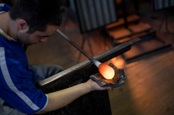 Theo Brooks blowing glass in Paris