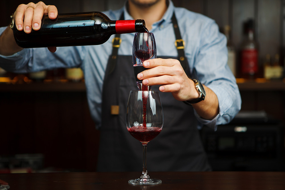 A red wine aerator will bring out the complexities of the wine faster