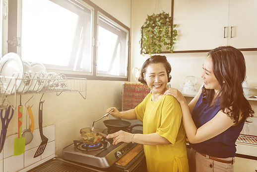 Mother and Daughter Cooking Together.jpg