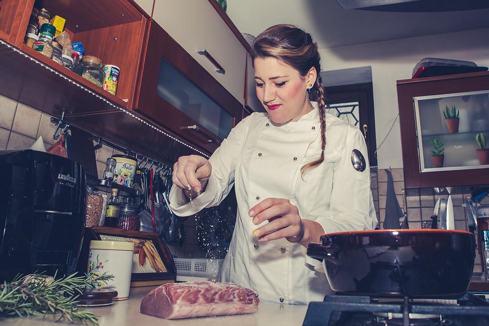 Chef Paola preparing the classic Arista alla Reggiana, part of the menu for the Emilia, I Love You cooking class