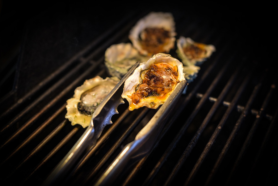 Impress your friends during your next dinner party - master how to prepare grilled oysters