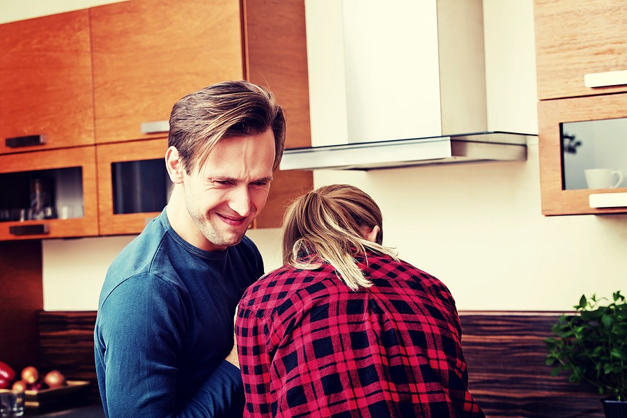 Couple laughing and having fun in kitchen