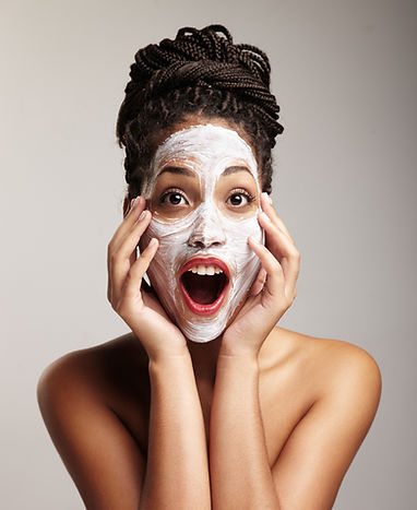 black woman have fun with a facial treat