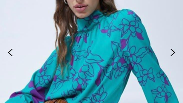 Green top with purple flower pattern