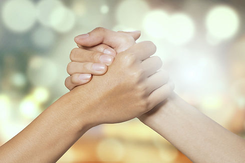 Closeup of two hands joining together, s