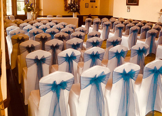 Chair covers with navy blue sashes demonstrating our first class sevice and attention to detail