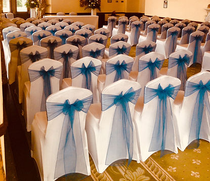 Chair cover hire featurin white lycra covers with blue organza sashes