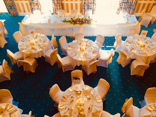A full set up in gold featuring our chair covers, sashes, table runners, centre pieces, swaging and LED light skirts.