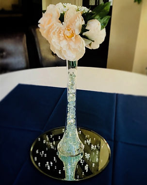 Centre piece featuring a peony bouquet, water beads, scatter crystals and a mirror plate