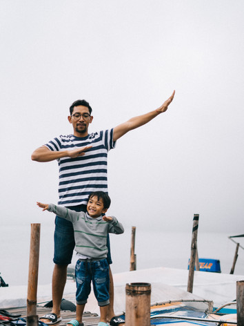 man-and-boy-standing-on-bridge.jpg