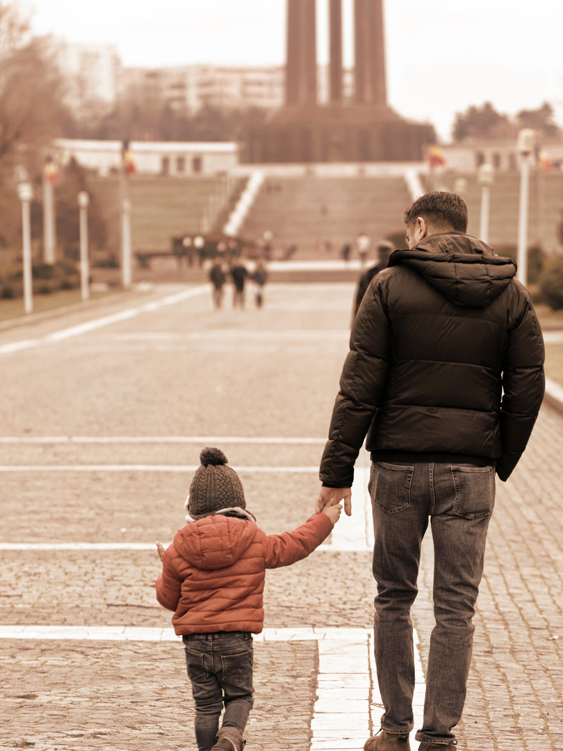 father-and-child-holding-hands.jpg