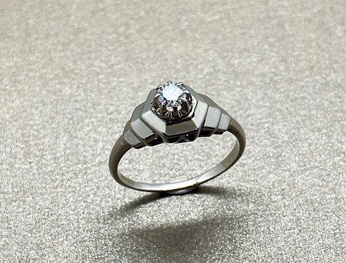 Solitaire Art Déco en or gris et diamant